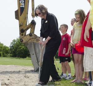 School board trustee Bonnie Danes puts the shovel into the ground on the spot where the new school in Stirling will sit at the ground-breaking ceremony, June 28. Jasper Construction Corporation will begin work immediately and said the school will open September 2013. Photo by Gail Paquette