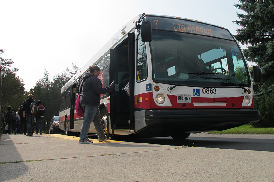 Students boarding a Belleville transit bus at the Loyalist Kente building. QNet News photo.