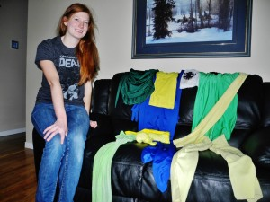 Becky Cocek shows off her homemade costumes at home in Trenton Tuesday afternoon. Photo by Matthew Blair