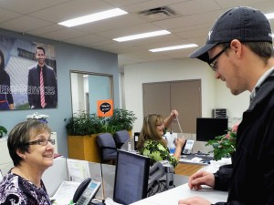 Loyalist College Admissions Receptionist Kathy Luffman helps second-year social service worker student Cody Boying during his visit to the financial aid office.  Photo: Amanda Lorbetski