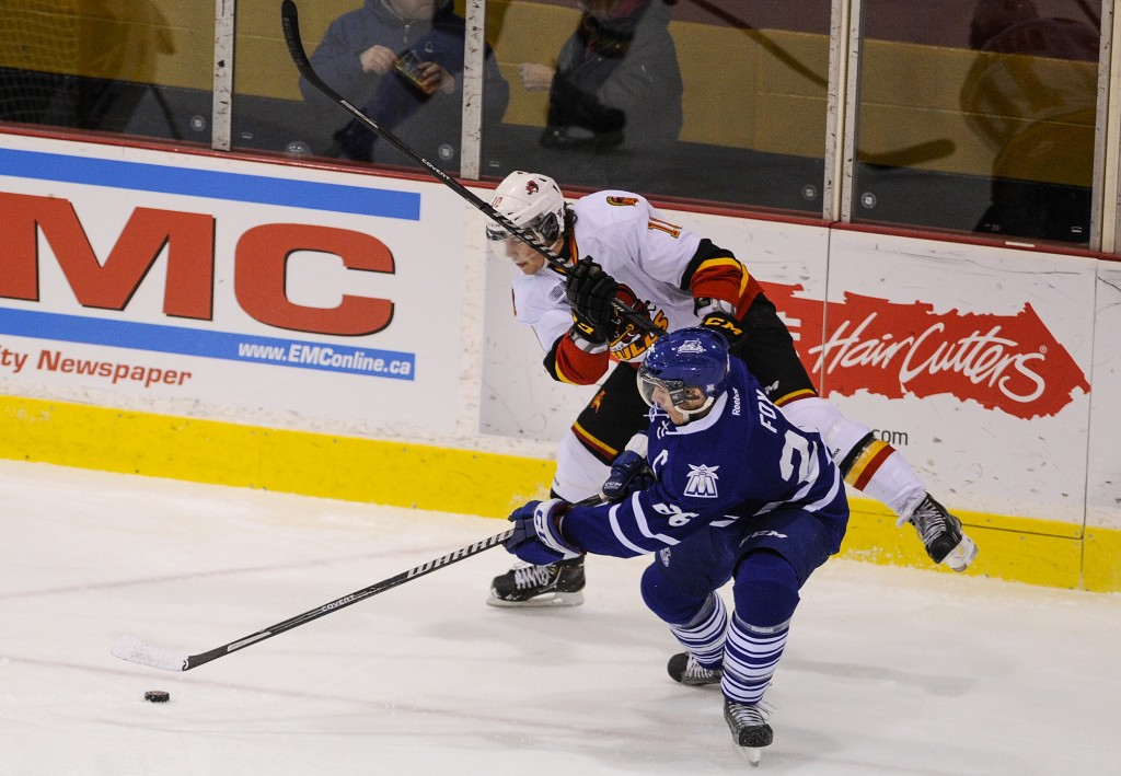 BELLEVILLE, Ont. Brett Foy (R) of the Mississauga Steelheads skates to the puck with Jake Marchment of the Belleville Bulls  Photo by Justin Chin