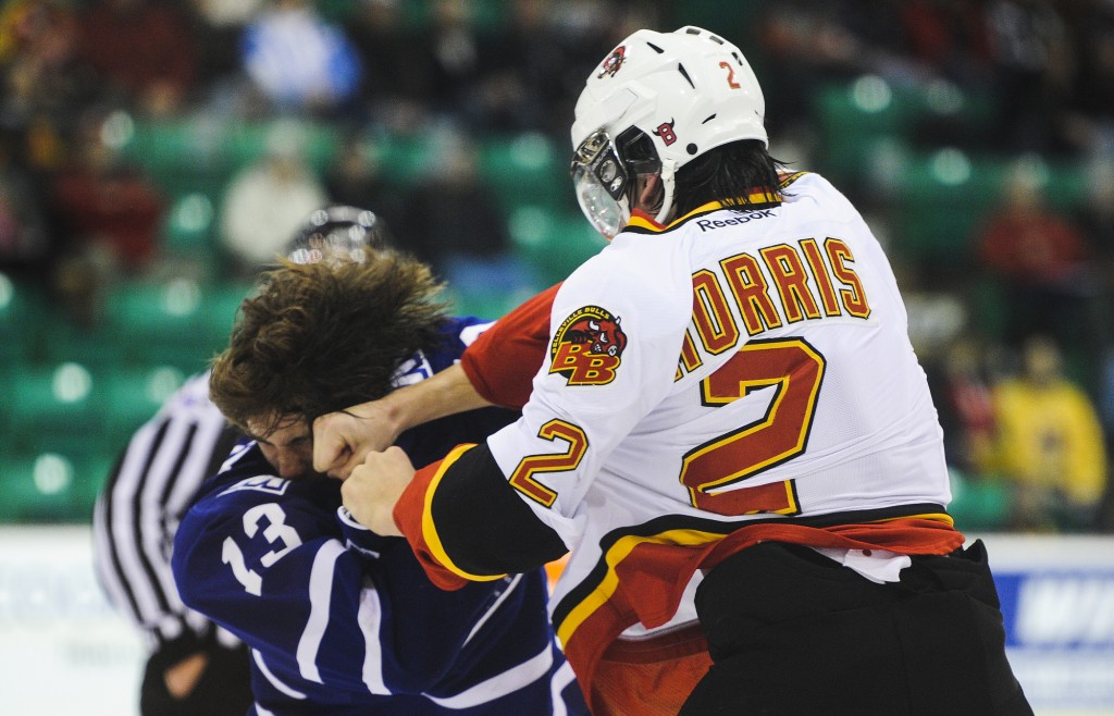BELLEVILLE, Ont. (27/11/2013)  Bobby MacIntyre (L) of the Mississauga Steelheads fights with Brody Morris (R) of the Belleville Bulls during the OHL hockey game between the Belleville Bulls and the Mississauga Steelheads on Wednesday, Nov. 27, 2013 at Yardmen Arena in Belleville, Ont. The fighting results in a 5 minutes penally for both players. The Belleville Bulls won with a 5-2 victory over the Mississauga Steelheads. Photo by Justin Chin
