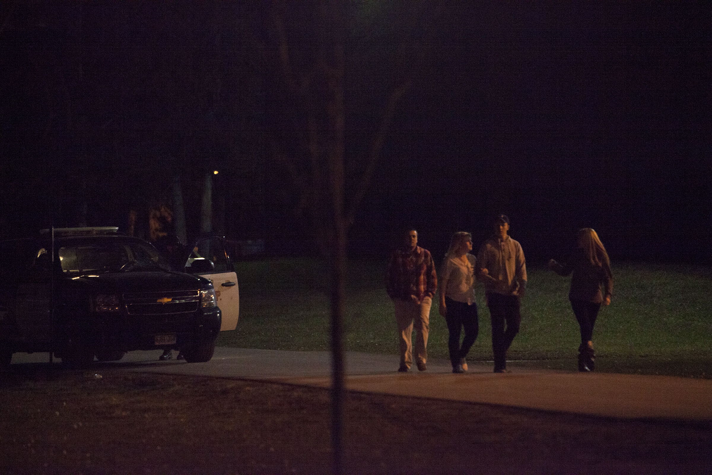 BELLEVILLE, Ont. - Students walk back home past an Ontario Provincial Police cruiser after Loyalist College entered a lockdown. Photo by Jack Carver