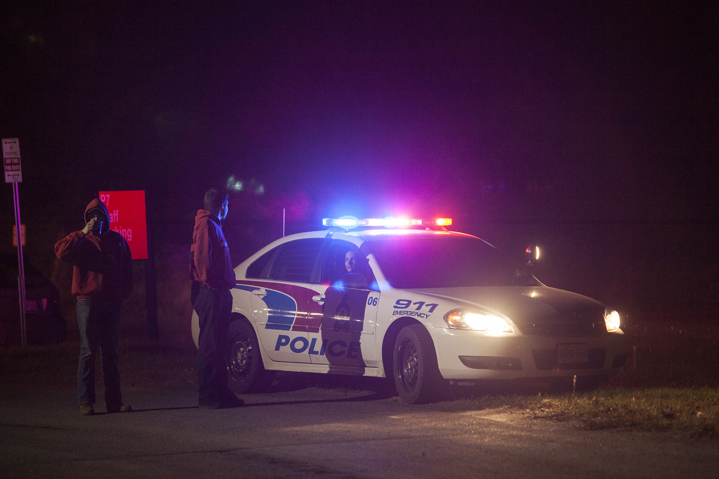BELLEVILLE, Ont. - Two residence assistants talk to the police blocking the road in between the school and New Residence at Loyalist College. Photo by Jack Carver