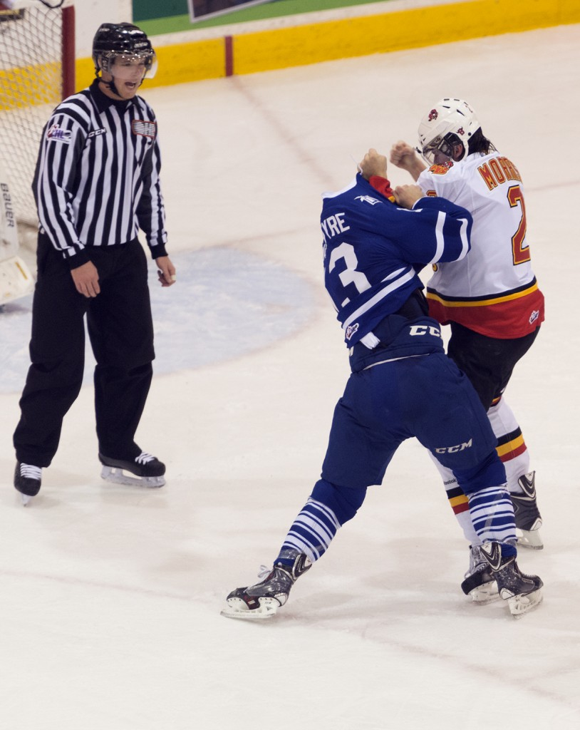 BELLEVILLE, Ont. (27/11/13) - Belleville Bull Brody Morris and Mississauga Stealhead Bobby MacIntyre duke it out during Wednesday night's game. The Belleville Bulls won 5 - 2. Photo by Sarah Taylor