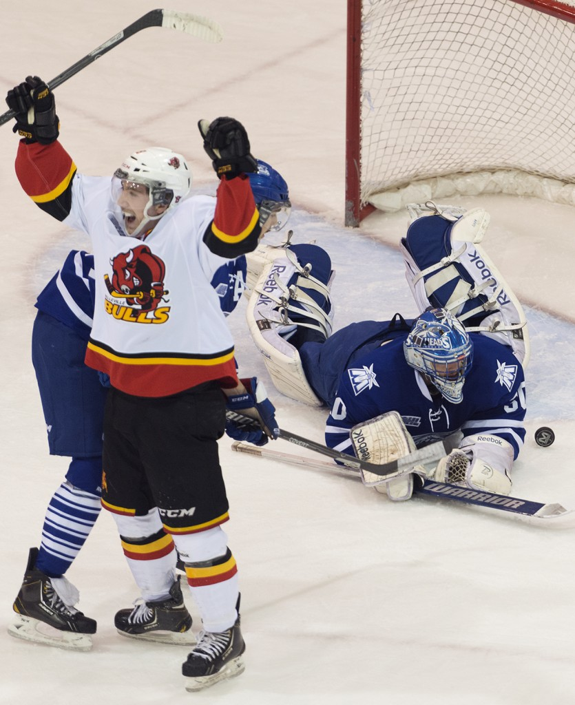 BELLEVILLE, Ont. (27/11/13) - Aaron Berisha scores the second goal of the night for the Belleville Bulls against Mississauga Stealheads' goalie Spencer Martin. The Bulls beat the Stealheads on Wednesday, Nov. 27 5 - 2. Photo by Sarah Taylor