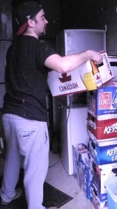 "BELLEVILLE – Brent Waldie stacks the empties he is donating to the ""Movember"" cause. Photo by Riley Maracle"