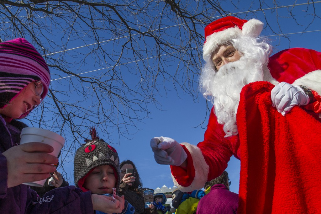 BELLEVILLE, Ont. (28/11/13). Santa gives out candy to eager children at the CP Train concert. Photo by Julia Karpiuk.