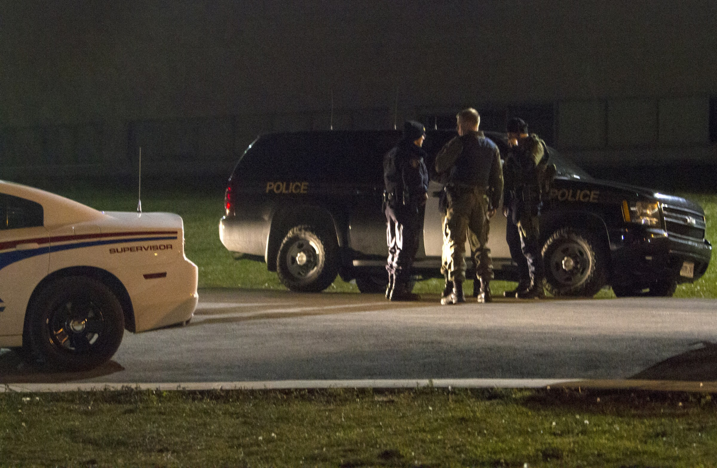 BELLEVILLE, Ont. (22/11/13) - Members of the Belleville Police and the Ontario Provincial Police block the roadway between Loyalist College and the residence located behind the school. Photo by Victoria Thoms.