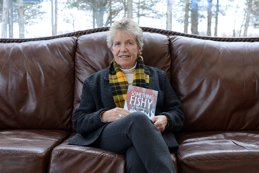 It's like family here - Hilary Macleod, with her new novel in tow, was visiting the school to invite more people to come by her launch on Nov. 21. She says she loves coming to the college to have her book launches, because they're so good and welcoming to her. Photo By Jack Carver.