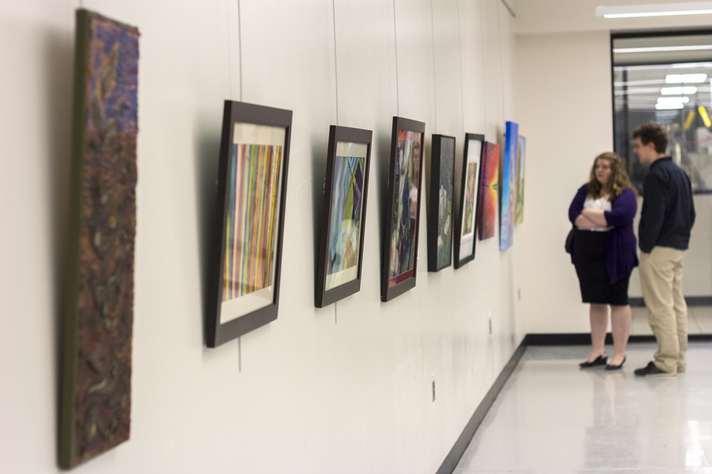 BELLEVILLE - The Art and Design program at Loyalist college hosted their annual open house starting yesterday, December 3rd and will run through to December 10th. Paintings and drawings and other fine art work is presented and being sold by students and local artists. Photo by Sonya Dronsfield