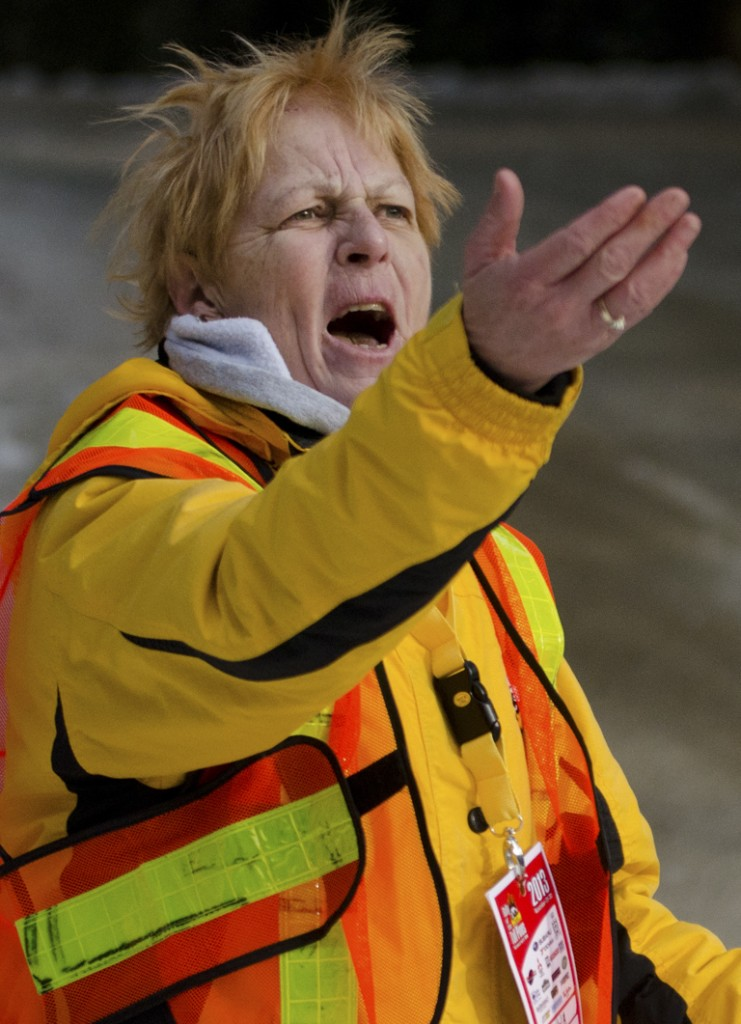 BANCROFT, Ont (30/11/2013) - Race official Donna Huber yells at drivers to slow down and watch their curves after a racer spun out and flipped into a ditch at the Rally of the Tall Pines held in Bancroft, Ont on Saturday November 30th, 2013. Photo by James Wood