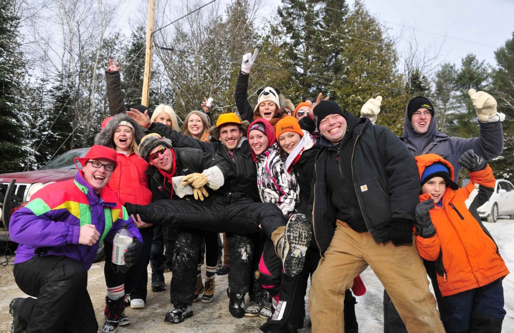 BANCROFT, Ont (30/11/2013) Crowd of rally fans brave the cold and gather and pose for a photo near the iron bridge section of the Rally of the Tall Pines saturday afternoon . Photo by Thomas Surian.