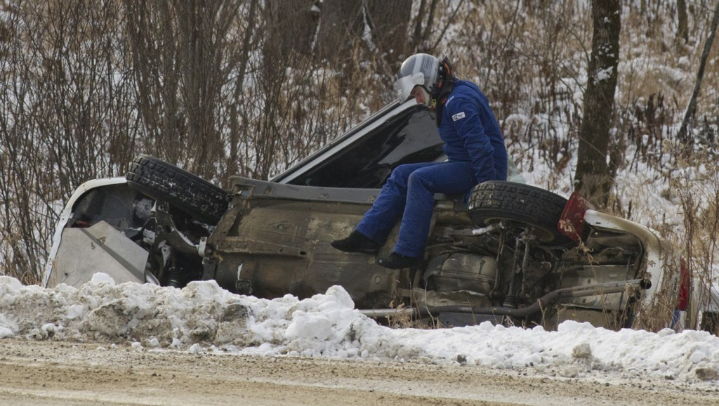 BANCROFT, Ont. [30/11/2013] Jeremy Norris climbs out of his 2000 Subaru Impreza 2.5RS while his co-driver John Merry remains trapped inside after slidding into a ditch, which flipped the car onto its side on Saturday, Nov. 30, 2013 at the 43rd annual Rally of the Tall Pines in Bancroft, Ont. The accident forced the team to withdraw from the rest of the events due to mechanical issues, ending their chances of placing. Photo by Kaitlin Abeele