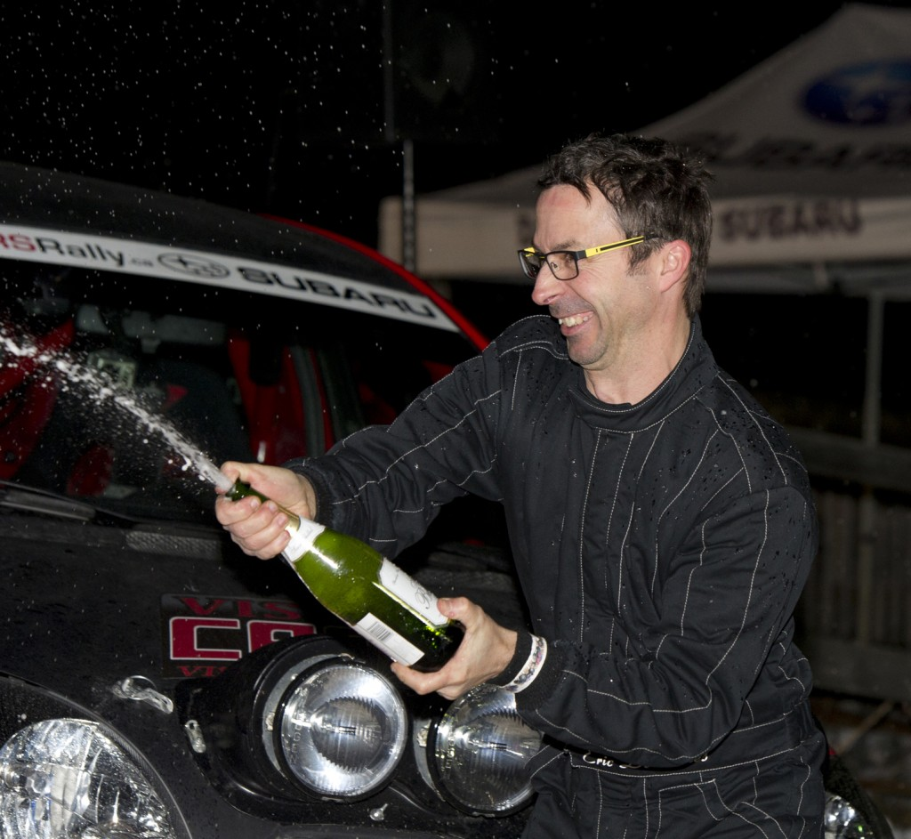 BANCROFT, Ont. [30/11/2013] Eric Deschenes sprays champaigne onto his 2004 Toyota Echo (Yaris V1) during the champaigne shower results ceremony at the 43rd annual Rally of the Tall Pines in Bancroft, Ont. on Saturday, Nov. 30, 2013. Dechenes, with his co-driver Catherine Asselin, placed 11th overall, and second in the National two-wheel production championship. Photo by Kaitlin Abeele