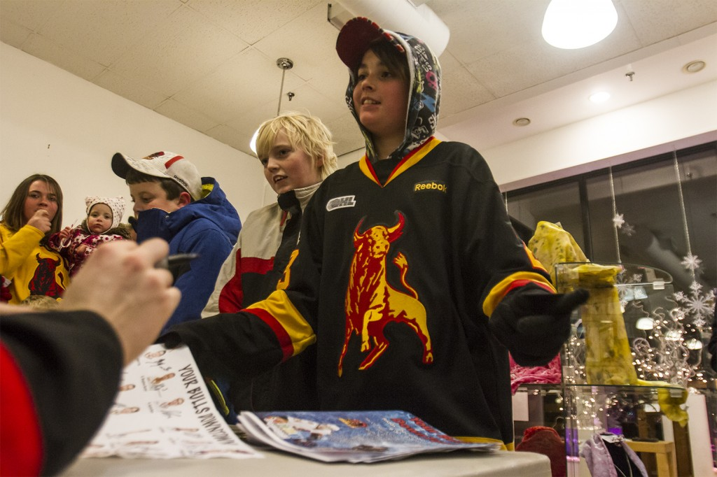 BELLEVILLE- A fan gets an autograph from Mark Raycroft and the Belleville Bulls meet and greet hosted in various locations downtown. Quinte Arts Council gallery was one of the many locations particpating. Photo by Julia Karpiuk.