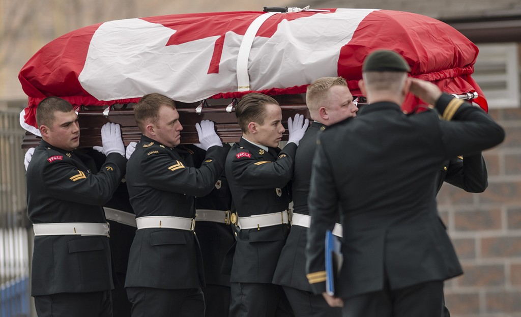 TRENTON – The coffin of Cpl. Adam Eckhardt is carried into the chapel at Canadian Forces Base Trenton Monday afternoon. Photo by Lacy Gillott, Loyalist Photojournalism.