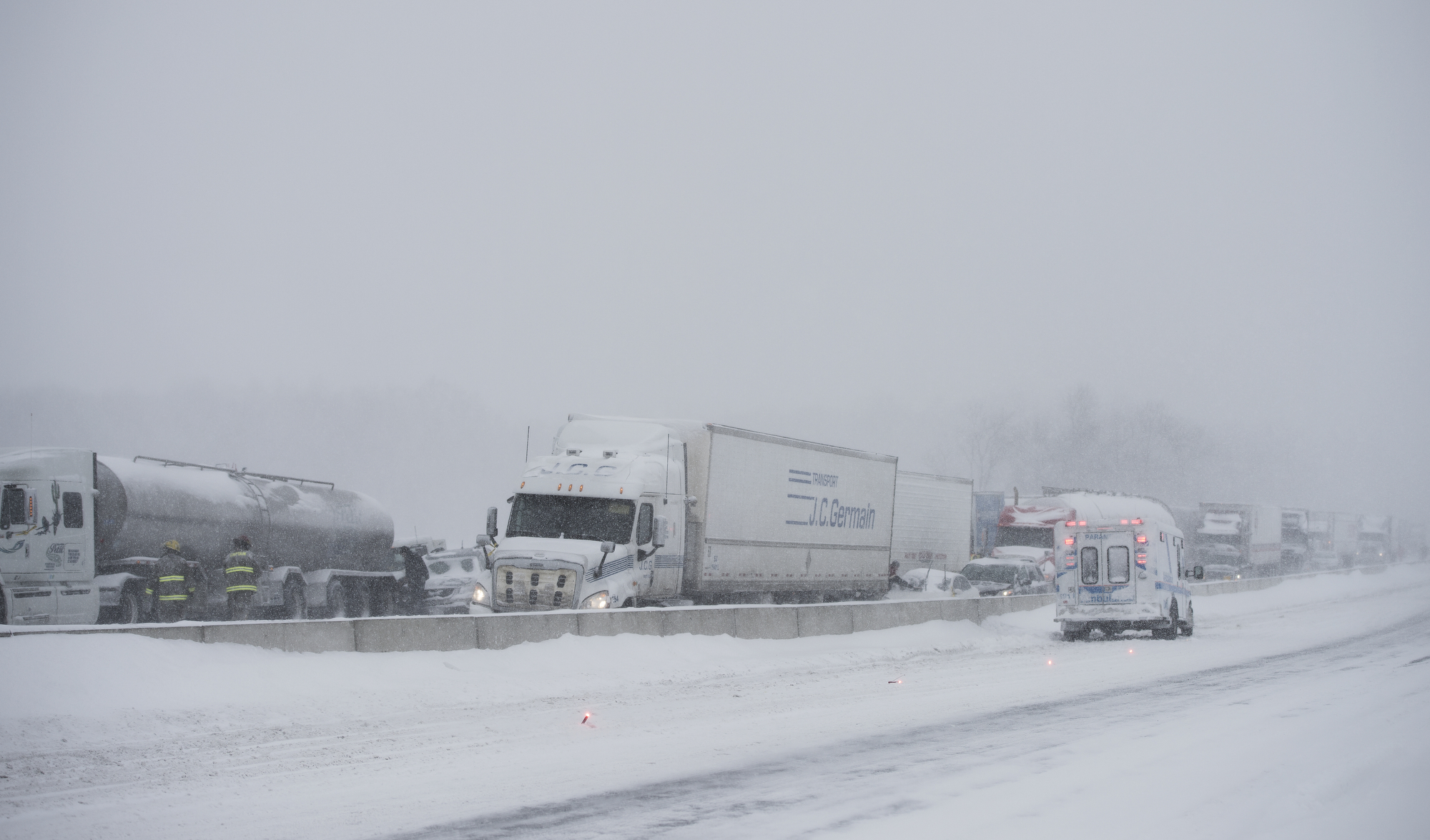 Rescue workers were at the scene of a multi-vehicle pileup on Highway 401 westbound between Glen Miller Road and Wallbridge-Loyalist Road in Quinte West on Wednesday. Photo by Justin Chin