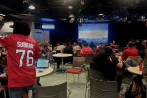 Students watching Canada take on Norway in men's hockey at the Shark Tank pub, inside Loyalist College. Photo by Andrew Heliotis