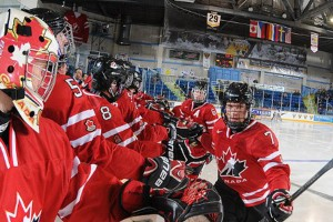 Jakob Chychrun (7) celebrates with teammates including Justin Lemcke (5) of the Belleville Bulls at the 2014 World Under-17 Hockey Challenge. Photo Courtesy of Hockey Canada