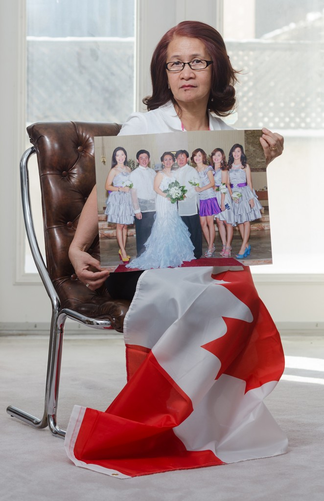 "TORONTO- Lilibeth Lacorte, 52, first moved to Canada from the Philippines in 2009 to work as a nanny.  Lacorte left her four daughters and her husband in Tacurong City in southern Mindano to find a better job.  ""Employment is scarce in the Philippines,"" says Lacorte.  She plans to sponsor her family to move to Canada to be with her once her permanent status application is processed.  Lacorte has been waiting over two years for her permanent status to be approved.  Photo by Emily Cumming"