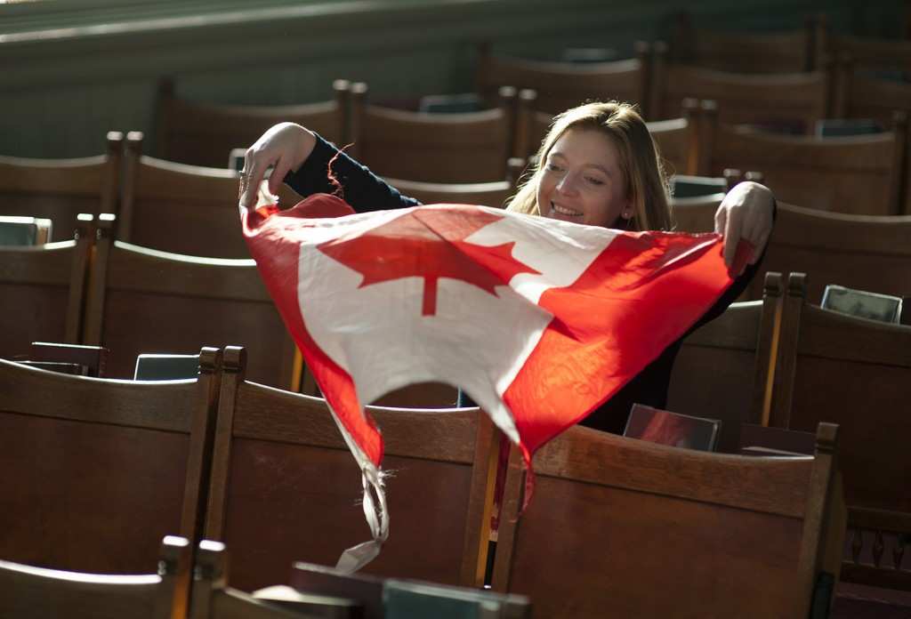 "BOWMANVILLE- Rev. Anita Sipos, St. Andrews Presbyterian  church, waves a Canadian flag in the nave of the church.  Sipos immigrated  to Canada in 2007 from Hungary where she grew up. ""I feel like the community here is not as together as it was back home, but I do like it,"" said Sipos. Photo by Justin Greaves"