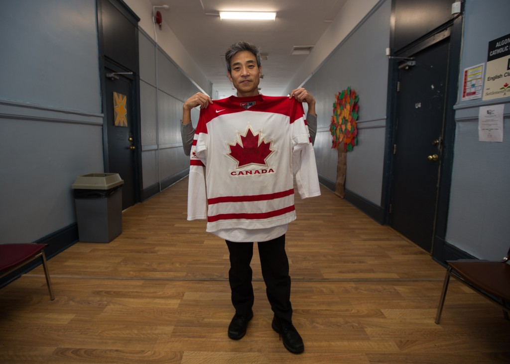 """BELLEVILLE- Hee Ok Kim stands outside his english  as a second language class at Loyola Adult High School,  Kim immigrated to Canada from South Korea on April 4th, 2012 with his wife, son and daughter. Kim used to work at a financial securities firm in Seoul. """"Canadians are very kind,"""" Kim says, """"Koreans are kind too but my country is so competitive and crowded,"""" he added. Photo by Jonathan King."""