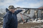 PRINC EDWARD COUNTY – Chris Byford shows what remains of his barn, which was more than 150 years old. Photo by Justin Greaves, Loyalist Photojournalism