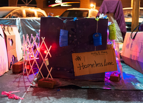 BELLEVILLE, Ont. (25/01/13) — People decorate their temporary home made by card box boxes at the annual fundraising event Sleep Out! So Others Can Sleep on Friday, Jan. 25, 2013 at Market Square, Belleville, Ont. The cold -12 degrees did not diminish the people's will to fundraise to help with ongoing costs of its four homeless shelters. Photo by Justin Chin