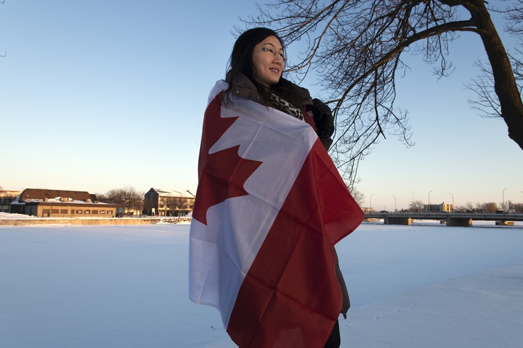 "BELLEVILLE - Born in Manila, Philippines, Paulina Uy moved to Canada for school in Aug. 2012 when she was 21-years-old. She will be graduating the photojournalism program at Loyalist College in Belleville this spring, and she has enrolled in the accounting program at Loyalist for the fall. While she misses her family and the traditional foods her mother cooks, she  is happy here and loves Canadian weather. ""Winter can be crazy but compared to the heat in the Philippines I love it here. I don't want to go home,"" she said. Uy and her family, which includes her mom, dad and two brothers have all applied for premenant residence and are in the fifth year of waiting for approval. Photo by Solana Cain"