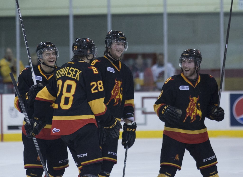 BELLEVILLE – Members of the Belleville Bulls are all smiles after winning their game against the Oshawa Generals on Wednesday evening. The win broke a three-game losing streak for the Bulls. Belleville 6-5 after a shootout. Photo by Suzy Willig, Loyalist Photojournalism