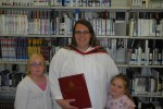 Kristina Boudreau poses with two of her children at the graduation reception. Photo by Bevan Hamilton.