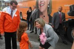 Andrea Horwath accepts flowers from a little girl after arriving in Belleville on Wednesday. Photo by Bevan Hamilton.