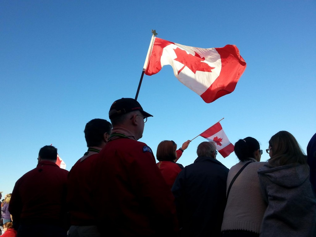 Terry Honour and with other members of the scouting community held a large Canadian flag. Honour said it was appropriate for them to wear their uniforms at the overpass. Photo by Taylor Broderick