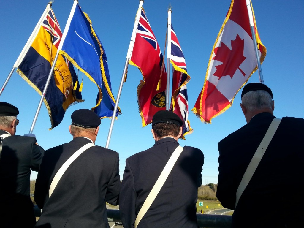 Members of the Royal Canadian Legion wore their uniforms and war medals at the Geln Miller Road overpass. Photo by Taylor Broderick