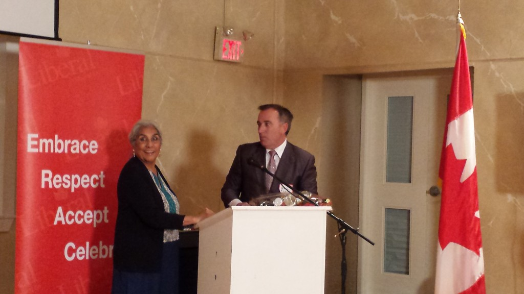 Federal Liberal candidate Neil Ellis presents a gift on behalf the Bay of Quinte Liberal Association in appreciation of her work.
