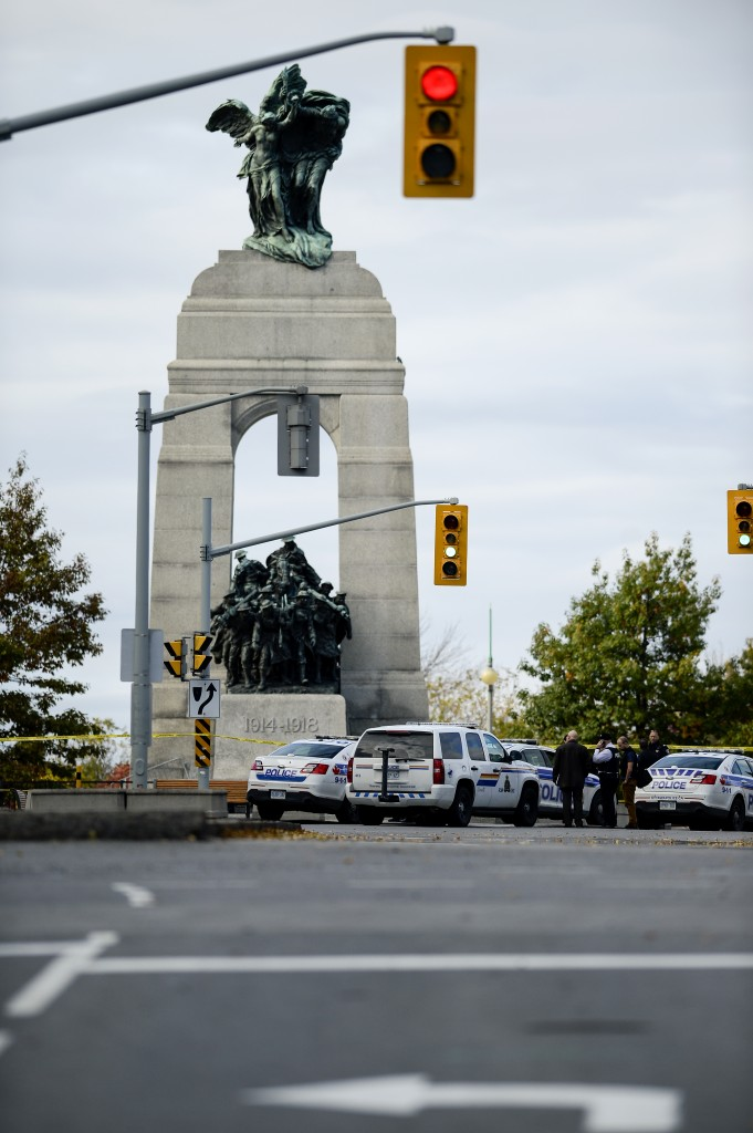 OTTAWA, Ont. (22/10/14) - Police and RCMP cars block the National War Memorial after an early morning shooting that has left two people dead including a member of the Canadian Armed Forces in Ottawa, Ont., on Tuesday Oct. 22, 2014. Photo by Andrew Lahodynskyj