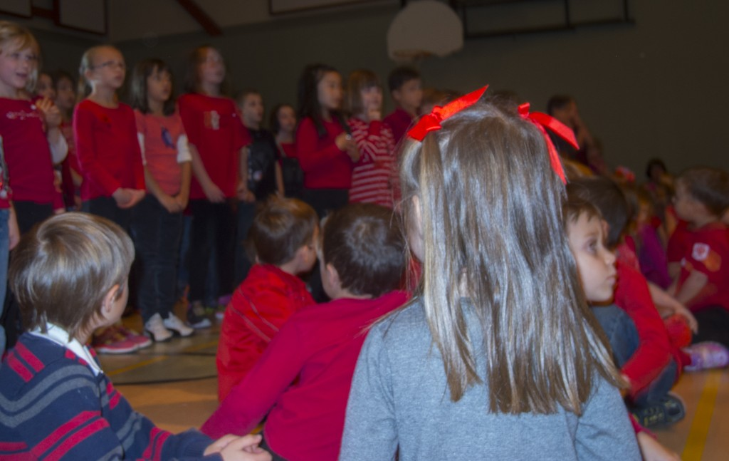 Students look on as school choir sings at Remembrance Day ceremony at L'Envol French elementary school. Photo by Kate Shumakova