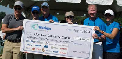 Medigas Celebrity Classic organizers celebrate this years fund-raising efforts at the Trillium Wood Golf Course in July of this year. Funds raised from the event supports children with physical disabilities, and community projects like the repair costs to the accesible part at Zwicks.  Photo by Candice-Rose Gagnon