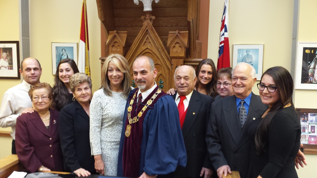 Newly elected mayor with family.  Photo by John R. Moodie