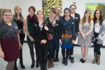 The students of arts and design foundations consider themselves a close group. They overcame a lot of struggles to put on an art showcase. From left to right: Krystiana Bourdage, Samantha Hein, Sonya Dronsfield, Shayna Reid, Professor Chrissy Poitras, Gina McCambridge, Linda Malik, Lydia Lambert, Shannon Lee, Shaneya Collins. Photo by Joseph Quigley.