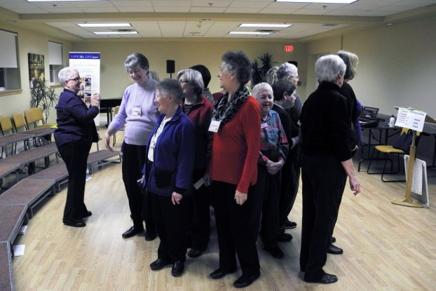 BELLEVILLE - Colleen Stickle (seperate from group) leads the Bay of Quinte Chorus in their warmups before practice. The Bay of Quinte Chorus is a chapter of the Sweet Adelines International, a global organization of women's barbershop choruses and quartets. Photo by Greg Murphy.
