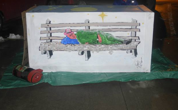 A pained cardboard box depicting the reality of homelessness at the CMHA Sleep-Out for the homeless event in January 2014. Photo by Suzanne Coolen