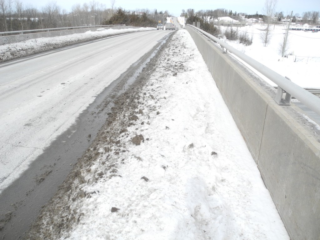 The current walkway at the Sidney Street overpass over highway 401 is low and covered in snow. Photo by Joseph Quigley.