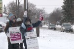 Photo By: Taylor Broderick. Employees of the Community Care Access Centre protest on Bridge St. East