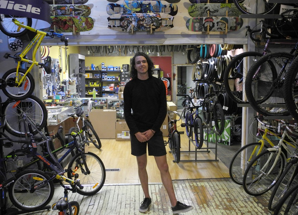 Adam Tilley stands in Ideal Bike Shop. Photo by Meaghan Bury