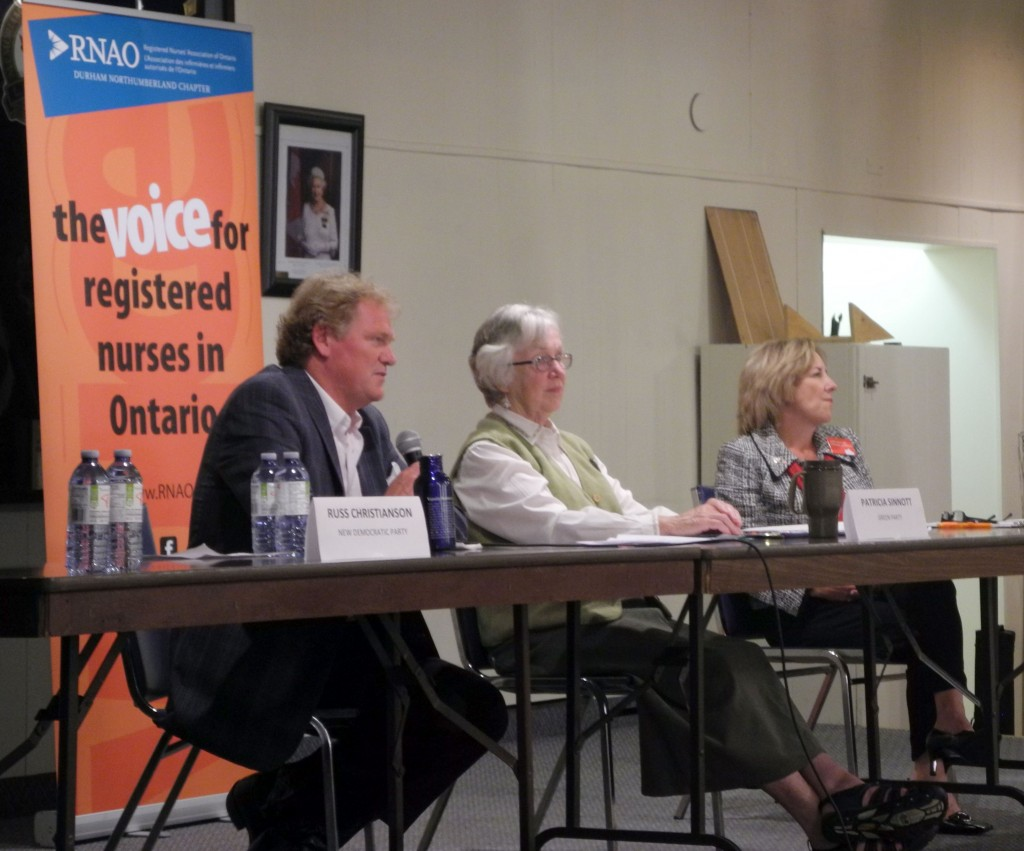 NDP candidate Russ Christianson (left), Green candidate Patricia Sinnott (middle) and Liberal Kim Rudd at the debate table in the Cobourg legion. Photo by Mo Cranker.