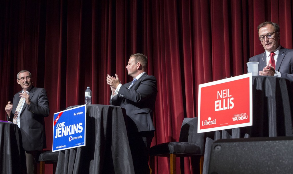 BELLEVILLE, Ont. (16/9/15)— Roudy audience members and police confrontation are only small pieces in the political puzzle at the Empire Theatre Wednesday evening during the Bay of Quinte election debate. Campaign members Terry Cassidy, Jodie Jenkins and Neil Ellis are each given turns in answering pre-meditated questions, as well as a few audience questions. Green candidate Rachel Nelems is not present to share her views, and neither is independent candidate Trueman Tuck, due to being barred from the debate. Photo by Hannah Lawson
