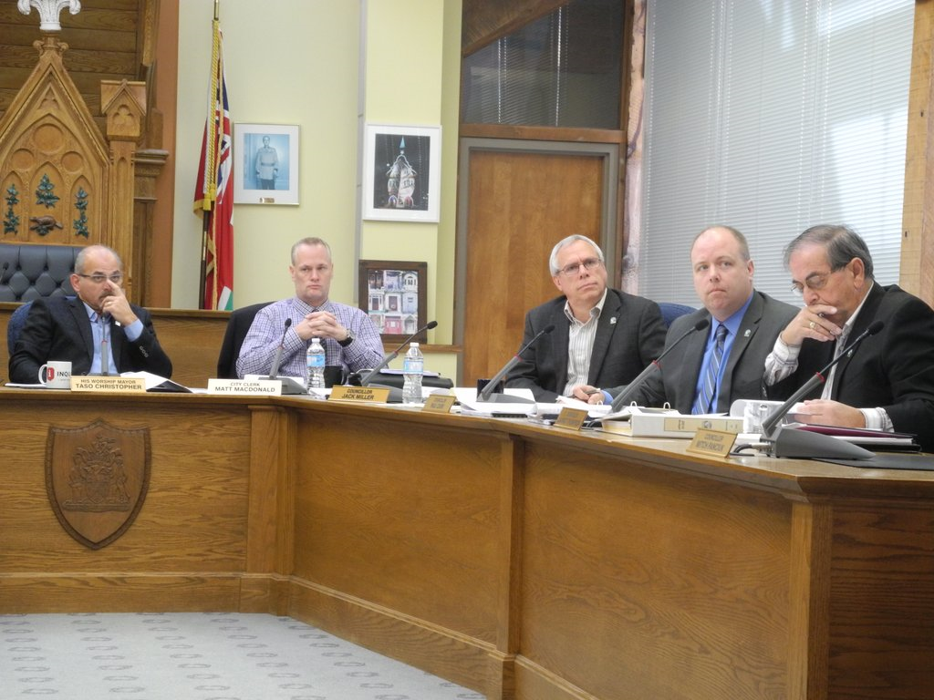 Mayor Taso Christopher (left), city clerk Matt MacDonald and councillors Jack Miller, Paul Carr and Garnet Thompson (far right) receiving a report on the status of the downtown revitalization project. Photo by Joseph Quigley.