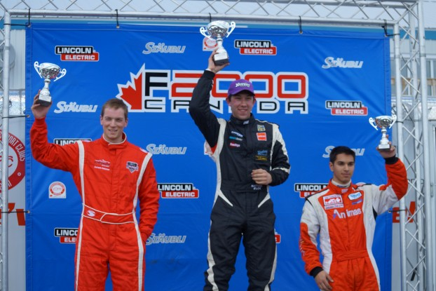 Nathan Blok (centre) standing victorious on the podium after a race at Canadian Tire Motorsport Park in Bowmanville, Ont. May 2, 2015. The race was part of the Canadian F2000 series. Zacharie Robicon came in 2nd (left) and Chase Pelletier came in 3rd for the race. Blok would go on to win the F2000 championship. Photo courtesy Nathan Blok